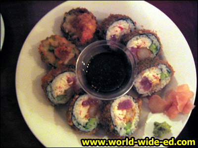 Volcano Roll - masago & katsuo bushi on a California roll with a special spicy sauce for $6.75