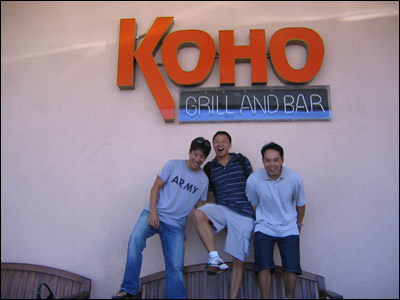 Having a little too much fun in front of the Koho Grill and Bar sign