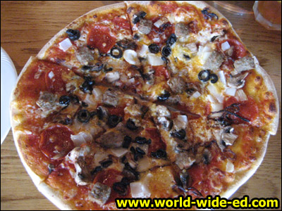 Terrace Special Combo Pizza - Marinara Sauce, Four Cheeses, Pepperoni, Italian Sausage, Mushrooms, Kula Onion, and Sliced Black Olives - $19