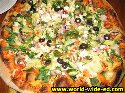 Kula Lodge Garden Fresh Vegetarian Pizza - Thick hand tossed dough with our Grilled Seasoned Vegetables & Feta Cheese - $17