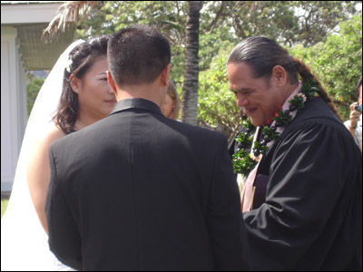 Susan and Reynold saying their vows (Photo courtesy of Donna Isara)