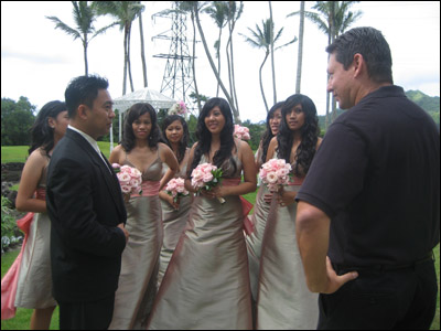 Dics giving last minute instructions to the videographer while the bridesmaids look on.