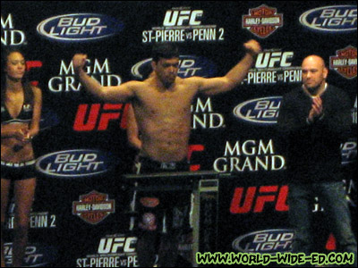 Lyoto Machida comes in at 206 as ring girls Logan Stanton and Arianny Celeste, and UFC President Dana White look on.