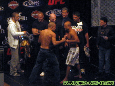 The much anticipated BJ Penn-Georges St Pierre stare down, as St.-Pierre's head trainer Firas Zahabi, an unknown male, UFC President Dana White, ring announcer Bruce Buffer, Penn's head trainer Rudy Valentino and fight matchmaker Joe Silva look on.