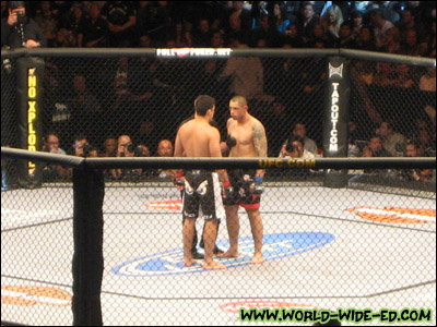 Lyoto Machida and Thiago Silva stare down each other as they get instructions from referee Yves Lavigne