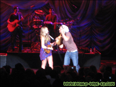 Colbie Caillat with her ukulele battling Justin Young on stage