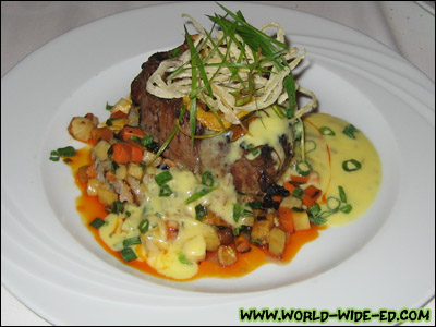 Grilled Filet of Angus Beef - Aged Cheddar Potato Cake, Roasted Root Vegetables and a Classic Bearnaise - $39