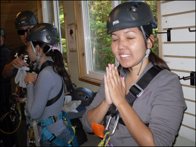 Leanne saying her prayers before flying through the air. [Photo credit: Lee Kojima]