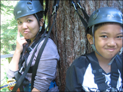 Leanne, who is deathly afraid of heights, holds back the tears after her first zip, while Chris smiles on