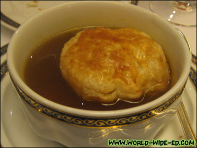 Oxtail En Croute - Flavorful classical soup slow-simmered and served in a crisp pastry crust
