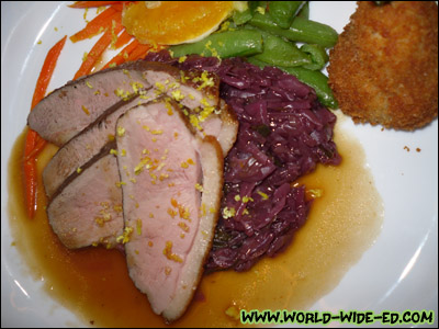 Duck Breast a l'Orange - The old-time favorite, oven roasted until crisp and served with a Grand Marriner sauce, braised red cabbage, pea pods, carrots julienne and William potato [Photo credit: Lee Kojima]