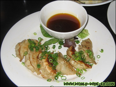 Seafood Gyoza - homemade shrimp & scallop dumplings served with chili soy - $9