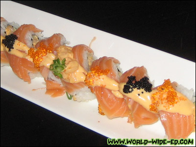Hottie Roll - spicy scallops, tobiko, cucumber, weapped with salmon - $12