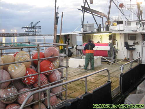 Boat unloading their catch [Photo Credit: Arthur Betts]