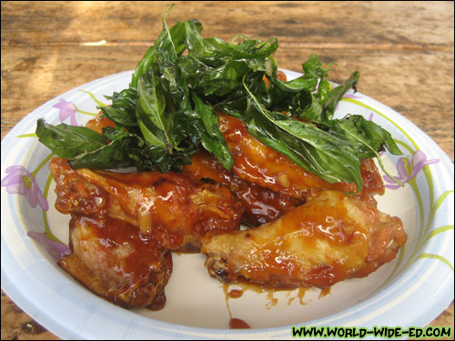 Spicy Glaze Garlic Chicken Wings (with deep fried basil) - $7.95