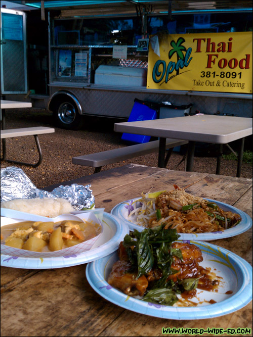 Our Yellow Chicken Curry, Shrimp Pad Thai and Spicy Glaze Garlic Chicken Wings in front of the Opal Thai Food Wagon