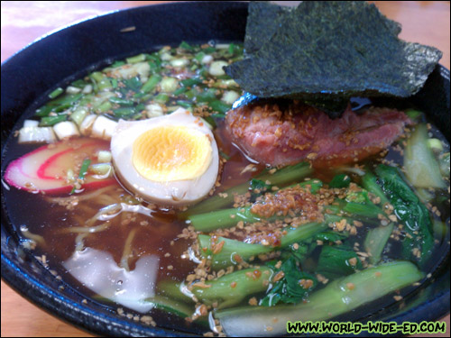 Soft Rib Ramen - Ribs are slowly cooked over 8 hours until tender & juicy. Ramen is served in a garlic shoyu base with traditional half cooked egg. Original Japanese style. - $8
