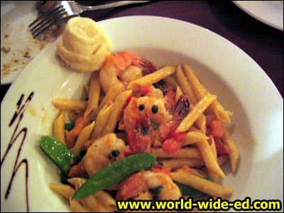 Sauteed Shrimp with Penne Pasta - A garlic white wine broth garnished with capers and tomatoes for $21