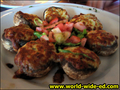 Stuffed Mushrooms - stuffed with petro & quattro formaggio, baked until golden for $6.95