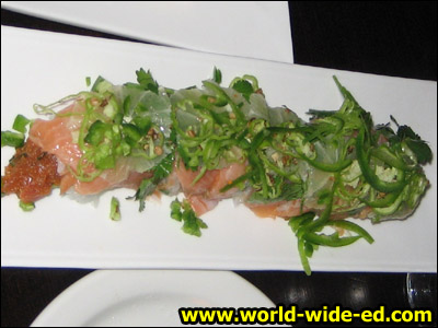 007 Roll - Spicy tuna, avocado, cucumber wrapped with salmon, lime, cilantro, shishito pepper & jalapeno ($12)