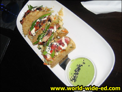 Ahi Tuna Tacos - Seared rare Ahi tuna, Asian coleslaw, wonton tacos, & wasabi-lime aioli. ($8.99)