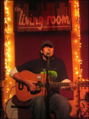 Justin gigging at The Living Room in New York City [Photo Courtesy Justin's MySpace]