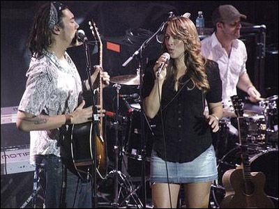Justin on stage with Colbie Caillat [Photo Courtesy Justin's MySpace]