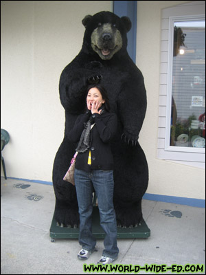 Wifey getting mauled, er petted by big bear.