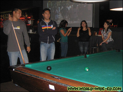 Shooting pool at Belltown Billiards