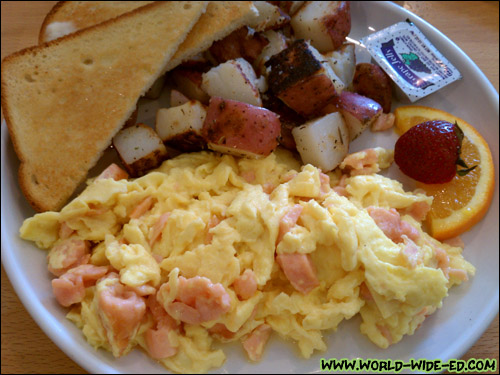 Lox and Eggs Scramble - Scrambled eggs and onions with smoked salmon. ($10.50)