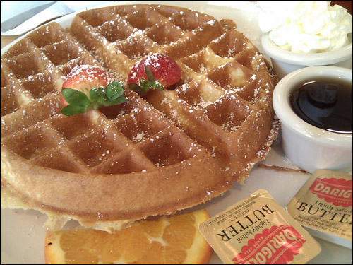 Belgian Malted Waffle - a light and crispy waffle dusted with powdered sugar, served with butter and syrup. ($6.95) (Photo Courtesy: Rick Nakama)