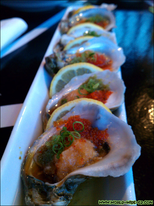 Oysters on the 1/2 Shell (Half dozen Gulf oysters served on shaved ice with citrus oroshi, tobikko, jalapeno masago, & spicy ponzu sauce - $12)