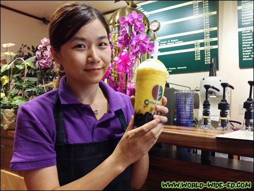 Coffee of Tea? Pearl Kai Owner Shuru Yang with their popular Passionfruit Smoothie
