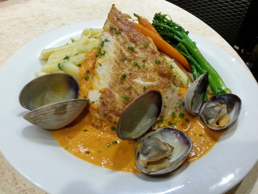 Catch of the Day: Pan seared opah over garlic penne pasta with spicy tomato basil cream sauce & fresh Manila clams