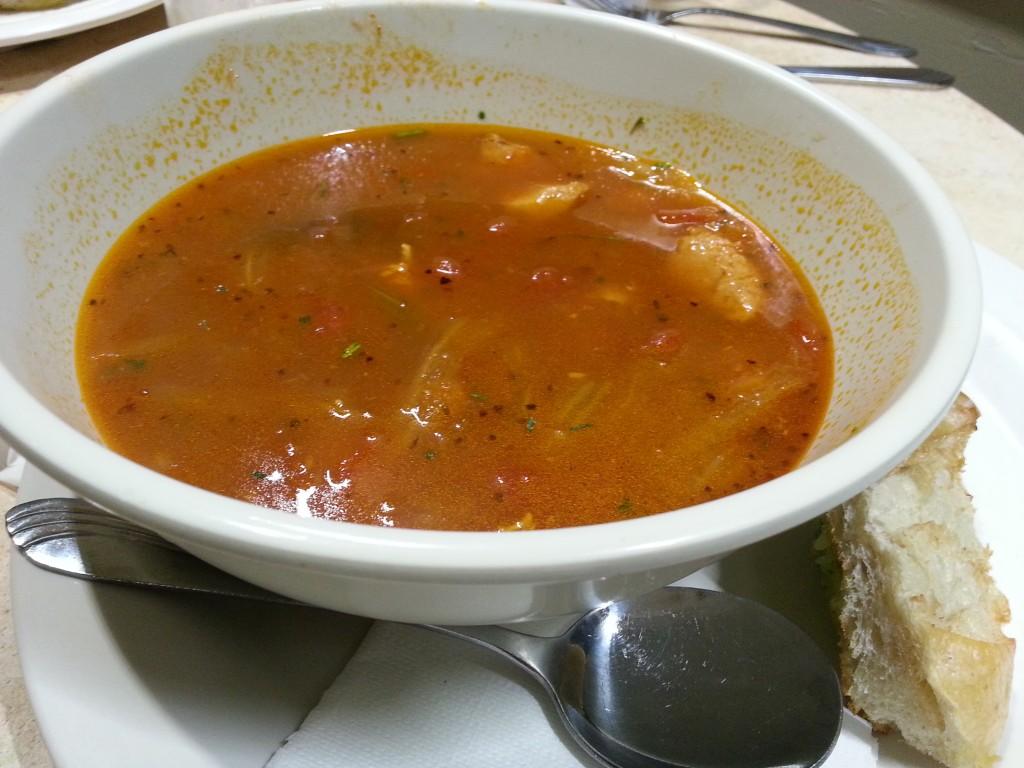 Bouillabaisse - Tomato saffron broth served with fish, clam and mussels. Served with sourdough garlic bread ($8)